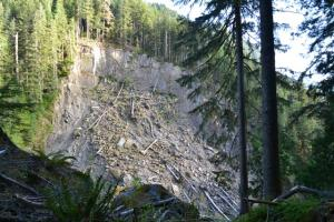 Landslide scarp across the river. Here the S. Fork is in a canyon.