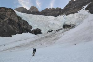 Walking quickly below the ice fall on the unnamed glacier on the west side of the South Face of Olympus.