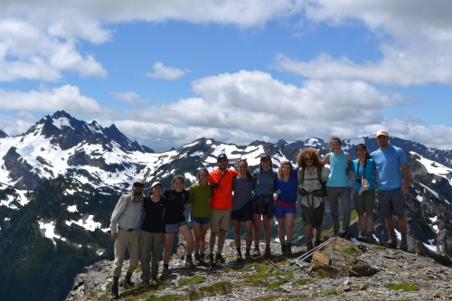 The group poses on Sentinel Peak, >20 trail miles from any road, with Mount Anderson in the background. From our high perch here in the inner core of the Olympic mountains, we looked down on soaring ravens, saw swallowtail butterflies rising and twirling together along the adjacent cliff face, found an alpine flower species endemic to the Olympic Mountains (isolated on high ridges by past climate changes), looked across the now free-flowing Elwha River and that valley's swathe of unbroken lowland forests, and contemplated the effects of anthropogenic climate change on Anderson's Eel Glacier and surrounding ecosystems. We would also take time here to individually think and write about the value of large ecosystem preserves (such as Olympic National Park), and the kind of remote wilderness recreation experience they afford as humanity enters the Anthropocene, and as nearby Seattle prepares to take on another 1.5 million people over the next 25 years. Photo Credit: Tim Billo